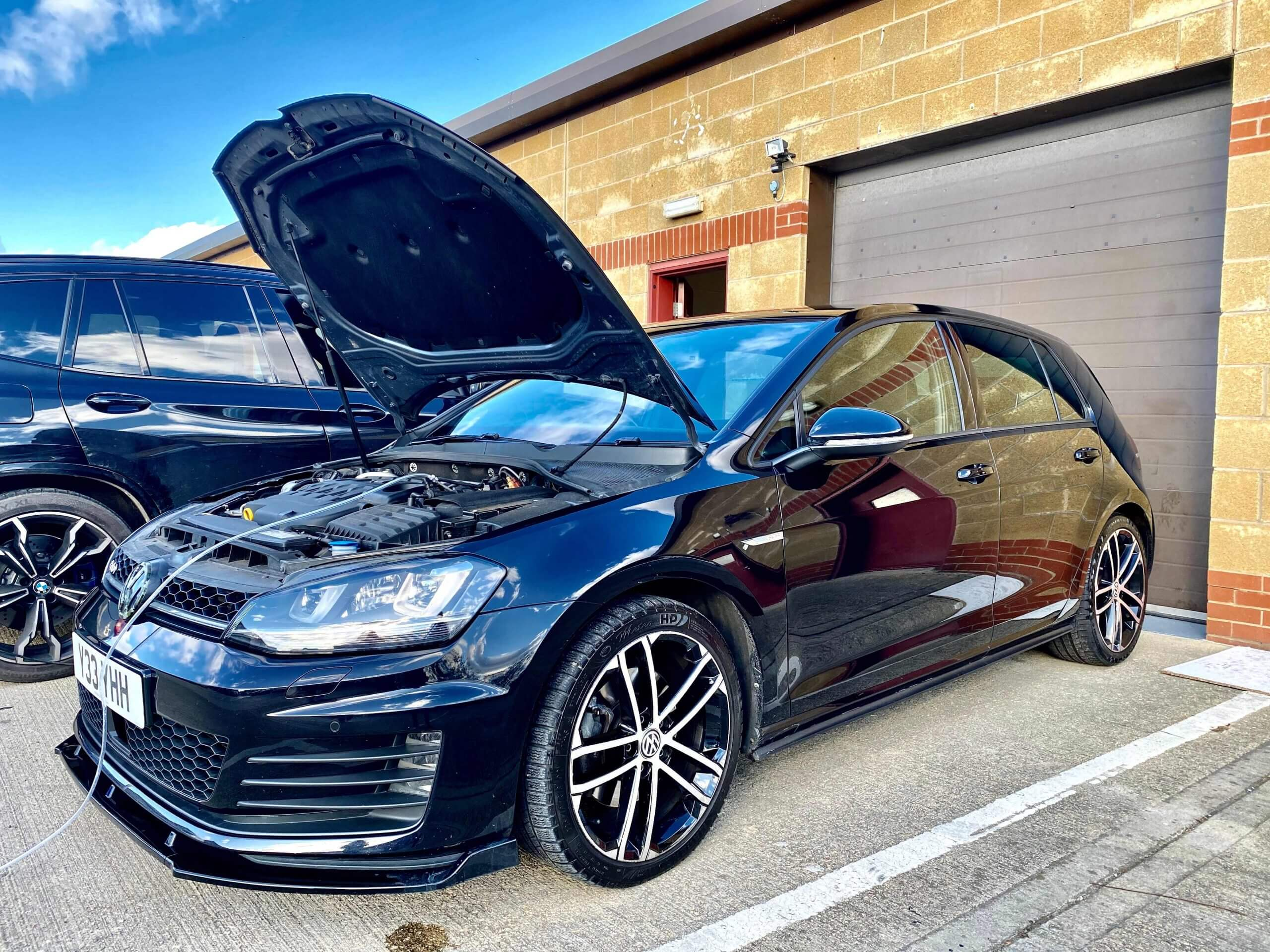 black Volkswagon having ODB remapped by top tuning