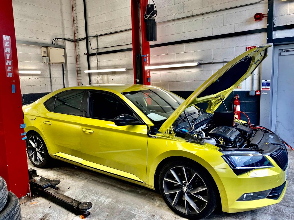 Lime green Skoda being mapped by top tuning