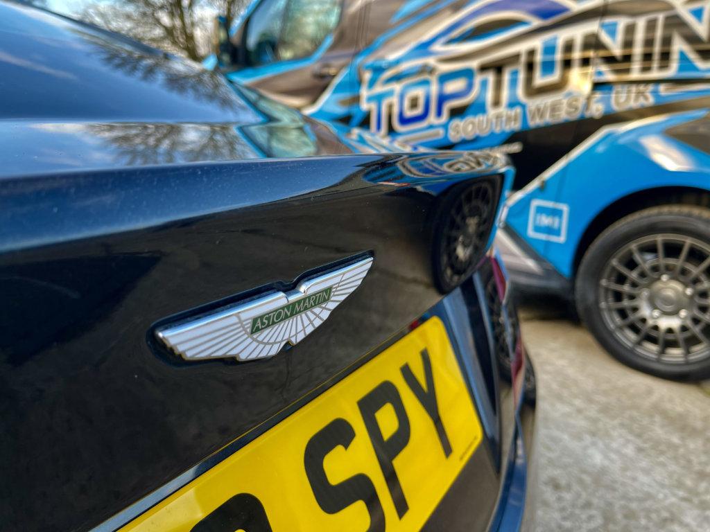 Close up of Aston Martin next to Top-tuning van